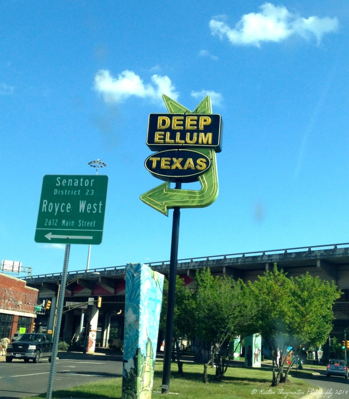 A cool road sign points the way to the Deep Ellum neighborhood.