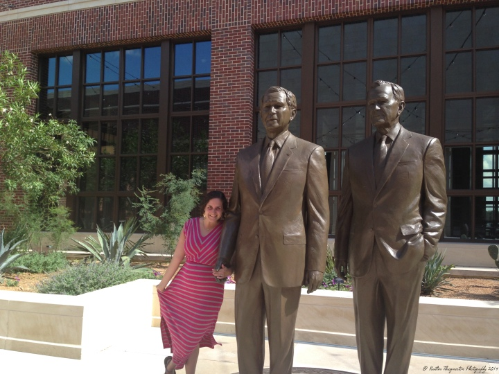 Just me and the two Bush presidents, hanging out. You know. (A photo of me next to sculptures of former President George Bush and his son, former President George W. Bush.