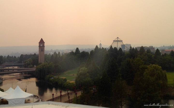 The skyline of Spokane tinted with ash from wildfires.