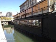 """Milan has its own series of canals, located in the Navigli District. While we viewed it during the daytime, I imagine it gets pretty lively at night, with most of the canal's """"barges"""" funtioning as bars."""