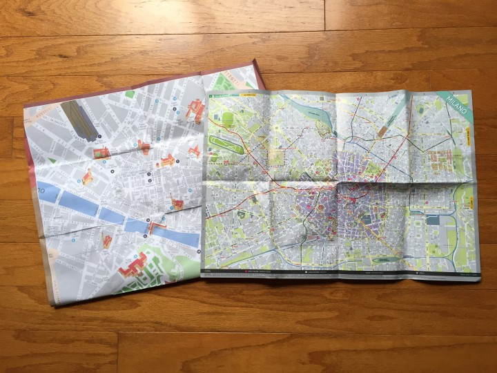 Paper maps of Florence and Milan